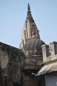 the temple spires seen from the courtyard of a home
