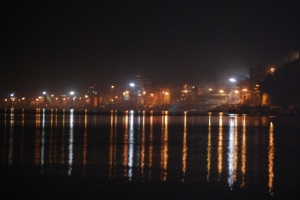 Reflections of Varanasi in the Ganges at night