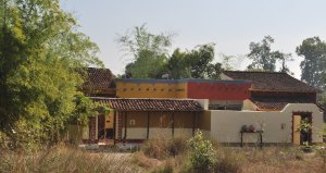 mud homes and terracotta tiled roofs