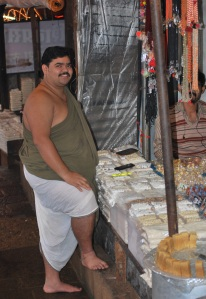 Healthy and happy Panditji( a priest) at the sweet shop