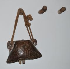 cow bells and  wooden coat hangers
