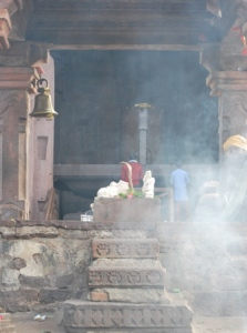 first glimpse of  the 21 m Bholeshwar Shivling through  smoke from incense sticks