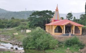 a colourful temple dots the landscape