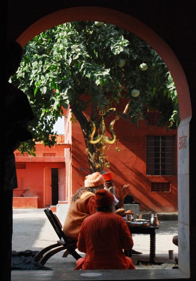 Sadhus through a doorway