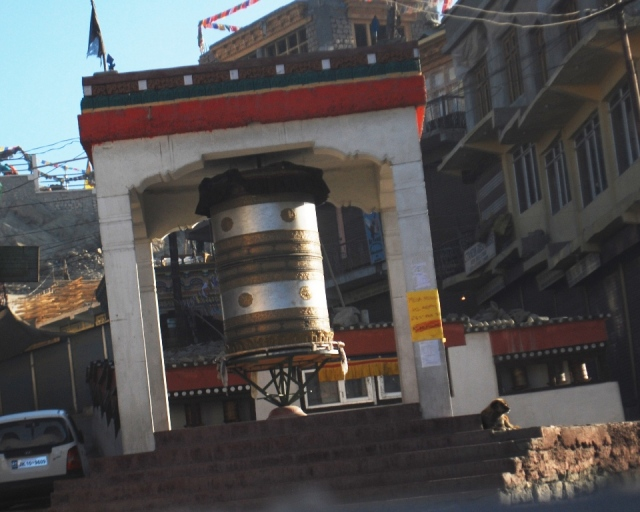 the prayer wheel and the dog
